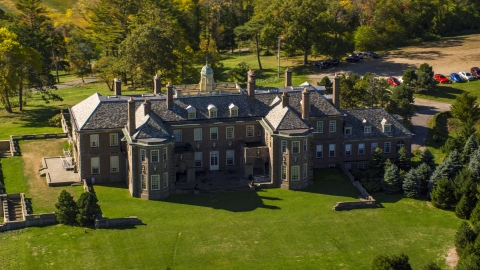 AX147_143.0000265 - Aerial stock photo of Close-up view of The Great House at Crane Estate in autumn, Ipswich, Massachusetts
