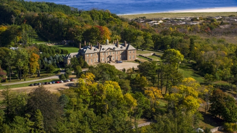 AX147_146.0000229 - Aerial stock photo of The Great House at Crane Estate atop Castle Hill in autumn, Ipswich, Massachusetts