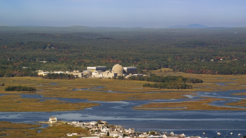 AX147_152.0000148 - Aerial stock photo of A nuclear power plant near the water in autumn, Seabrook, New Hampshire