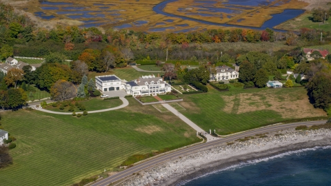 AX147_160.0000040 - Aerial stock photo of An oceanfront mansion in autumn, North Hampton, New Hampshire