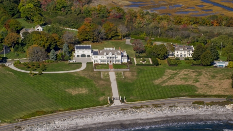 AX147_160.0000171 - Aerial stock photo of A view of an oceanfront mansion in autumn, North Hampton, New Hampshire