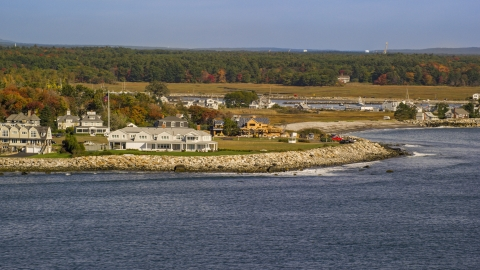 AX147_162.0000106 - Aerial stock photo of Oceanfront homes and new construction, autumn, Rye, New Hampshire