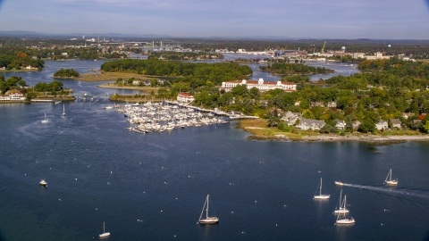 AX147_171.0000042 - Aerial stock photo of Wentworth By The Sea hotel by the marina in autumn, New Castle, New Hampshire