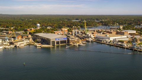 AX147_174.0000197 - Aerial stock photo of A naval shipyard in autumn, Kittery, Maine