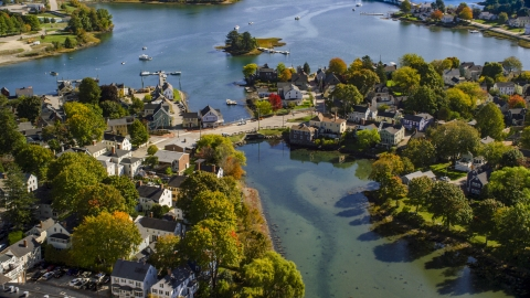 AX147_185.0000060 - Aerial stock photo of A small bridge and waterfront homes in autumn, Portsmouth, New Hampshire
