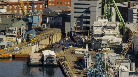 AX147_188.0000083 - Aerial stock photo of A submarine in a naval shipyard, Kittery, Maine