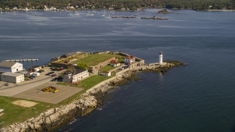 AX147_192.0000271 - Aerial stock photo of Lighthouse and fort on New Castle Island in autumn, New Castle, New Hampshire
