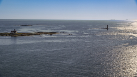 AX147_193.0000000 - Aerial stock photo of A lighthouse in the middle of the water, Kittery, Maine