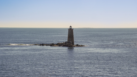 AX147_194.0000096 - Aerial stock photo of A lighthouse in the middle of the water, Kittery, Maine