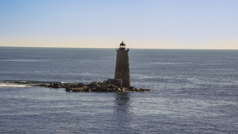 AX147_194.0000204 - Aerial stock photo of A lighthouse with the ocean in the background, Kittery, Maine