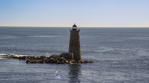 AX147_194.0000260 - Aerial stock photo of A view of a lighthouse overlooking the ocean, Kittery, Maine