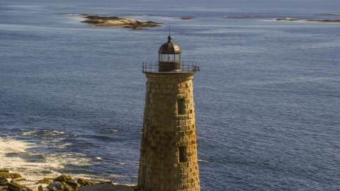 AX147_195.0000122 - Aerial stock photo of The top of a lighthouse by the water, Kittery, Maine