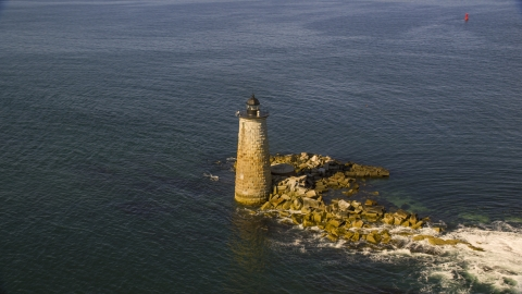 AX147_196.0000000 - Aerial stock photo of A lighthouse in the water by rocky shore, Kittery, Maine
