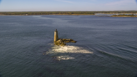 AX147_196.0000233 - Aerial stock photo of Lighthouse and rocks in the water, Kittery, Maine