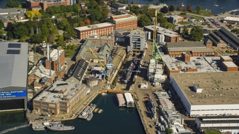 AX147_202.0000072 - Aerial stock photo of A submarine at the Portsmouth Naval Shipyard, Kittery, Maine