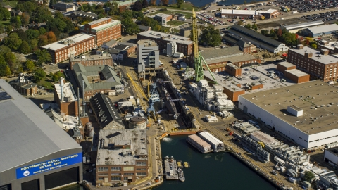 AX147_202.0000178 - Aerial stock photo of Submarine docked at Portsmouth Naval Shipyard, Kittery, Maine