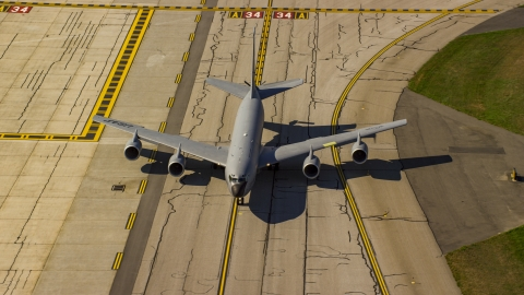 AX147_217.0000000 - Aerial stock photo of A military plane on runway, Portsmouth International Airport, New Hampshire