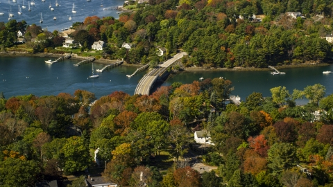 AX147_226.0000150 - Aerial stock photo of A small bridge and colorful autumn trees, Kittery, Maine