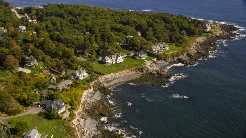 AX147_233.0000213 - Aerial stock photo of Upscale oceanfront homes in autumn, York, Maine