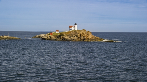 AX147_236.0000165 - Aerial stock photo of Cape Neddick Light in York, Maine