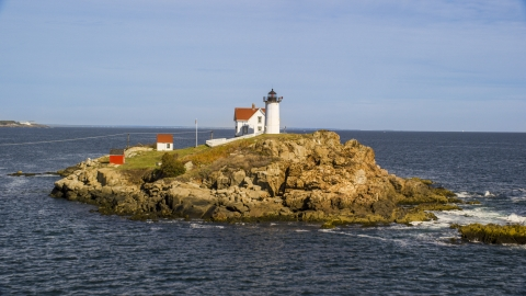 AX147_237.0000000 - Aerial stock photo of Cape Neddick Light overlooking the ocean, York, Maine
