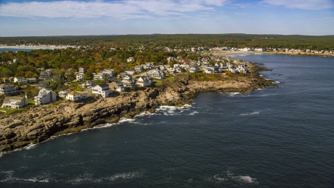 AX147_244.0000114 - Aerial stock photo of A coastal town on a rocky shore in autumn, York, Maine