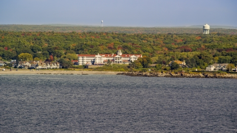 AX147_254.0000017 - Aerial stock photo of The Colony Hotel surrounded by colorful trees, autumn, Kennebunkport, Maine