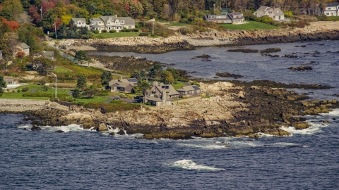 AX147_256.0000271 - Aerial stock photo of The Bush Compound by the rocky coastline in autumn, Kennebunkport, Maine
