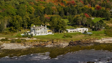 AX147_301.0000077 - Aerial stock photo of Oceanfront mansions, colorful autumn trees, Cape Elizabeth, Maine