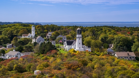 AX147_306.0000113 - Aerial stock photo of Cape Elizabeth Light in a coastal town in autumn, Cape Elizabeth, Maine