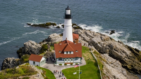 AX147_315.0000014 - Aerial stock photo of Portland Head Light by the ocean autumn, Cape Elizabeth, Maine
