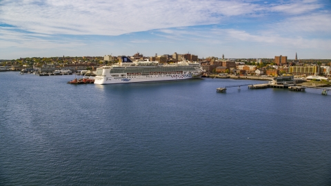 AX147_322.0000000 - Aerial stock photo of cruise ship docked at a pier, autumn, Portland, Maine