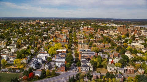 AX147_325.0000213 - Aerial stock photo of Apartments and Saint Dominics Roman Catholic Church, autumn, Portland, Maine