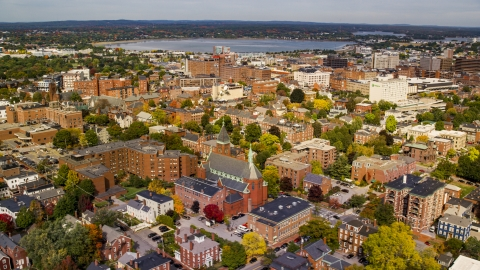 AX147_326.0000187 - Aerial stock photo of A view of apartments near Saint Dominics Roman Catholic Church, autumn, Portland, Maine