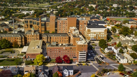 AX147_353.0000223 - Aerial stock photo of The Maine Medical Center building in autumn, Portland, Maine