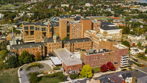 AX147_353.0000308 - Aerial stock photo of The Maine Medical Center hospital building in autumn, Portland, Maine