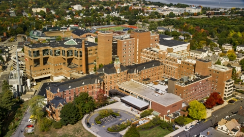 AX147_353.0000389 - Aerial stock photo of A hospital building, the Maine Medical Center, autumn, Portland, Maine