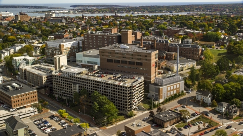 AX147_356.0000000 - Aerial stock photo of The Maine Medical Center, autumn trees, Portland, Maine