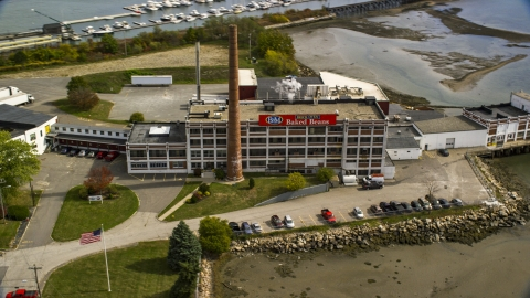 AX147_360.0000265 - Aerial stock photo of A small factory building in autumn, Portland, Maine