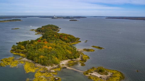 AX147_367.0000078 - Aerial stock photo of Clapboard Island with colorful autumn trees, Falmouth, Maine