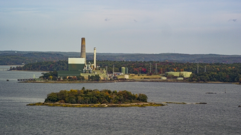 AX147_368.0000000 - Aerial stock photo of Wyman Energy Center on a cloudy day in autumn, Yarmouth, Maine