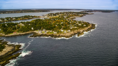 AX147_378.0000290 - Aerial stock photo of A coastal town on Bailey Island in autumn, Harpswell, Maine