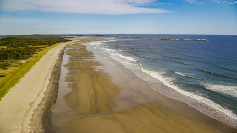 AX147_385.0000067 - Aerial stock photo of Waves rolling onto the beach in autumn, Phippsburg, Maine