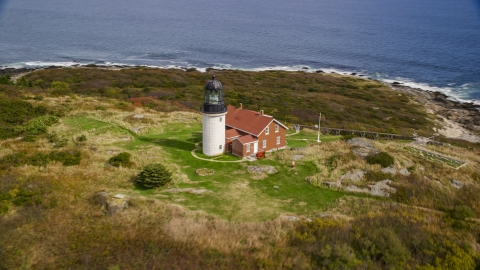 AX147_389.0000269 - Aerial stock photo of Seguin Light in autumn, Phippsburg, Maine