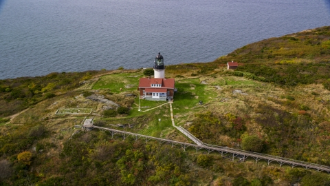 AX147_390.0000033 - Aerial stock photo of Seguin Light on Seguin Island with autumn foliage, Phippsburg, Maine