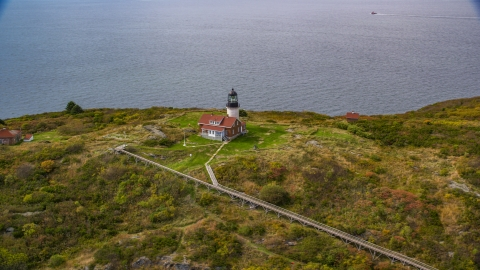 AX147_390.0000113 - Aerial stock photo of A view of Seguin Light on Seguin Island, autumn foliage, Phippsburg, Maine