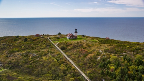 AX147_390.0000239 - Aerial stock photo of Seguin Light on Seguin Island in autumn, ocean in the background, Phippsburg, Maine