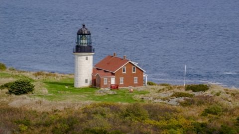 AX147_393.0000000 - Aerial stock photo of Seguin Light on Seguin Island, autumn foliage, Phippsburg, Maine
