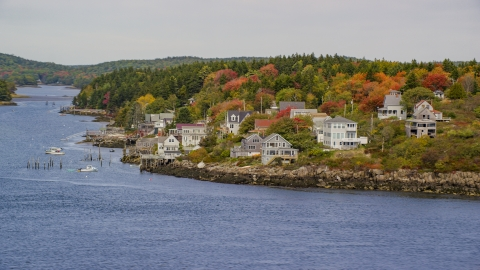 AX147_397.0000202 - Aerial stock photo of Waterfront homes, colorful trees in autumn, Georgetown, Maine