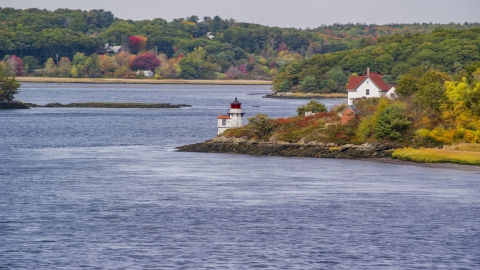 AX147_402.0000000 - Aerial stock photo of Squirrel Point Light and autumn foliage, Arrowsic, Maine